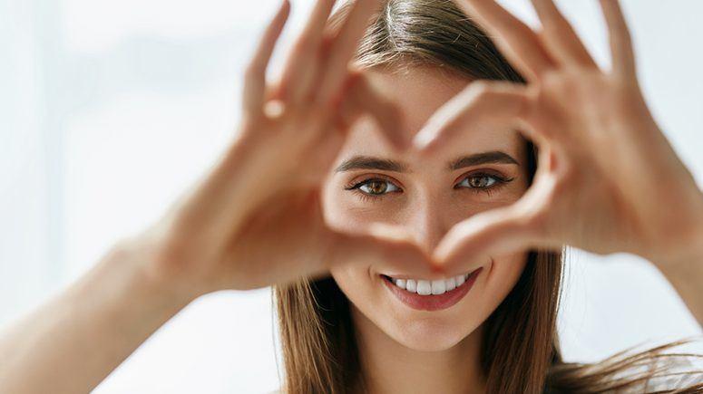 Girl showing heart