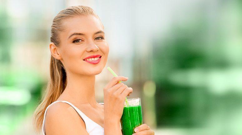 Woman drinking green shake
