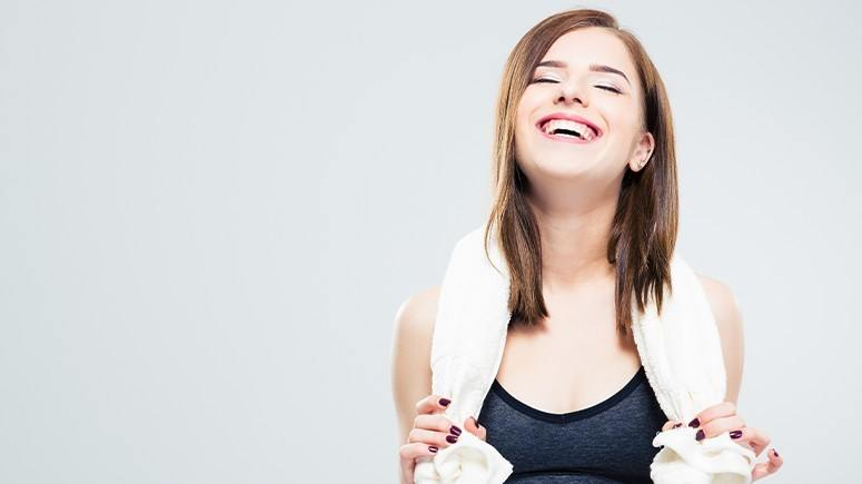 Girl laughing with towel