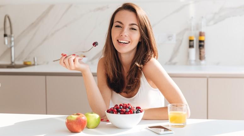 girl eating happily